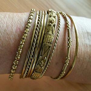 Jewelry - 9 brass bangles + one wide one too
